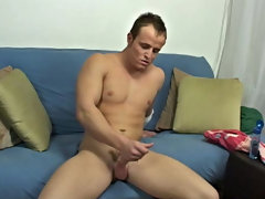 Sitting on the edge of the sofa naked, he started to wank his shlong with some lube