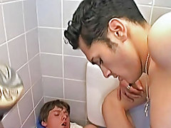 This duo, set in a toilet, features nightfall darkness haired beauty Mecury who has a fat cock with a long foreskin that cums in Vito's stronger