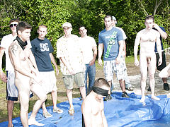 these poor pledges had to play blind folded in this hole in the ground filled with water muscle groups pictures me