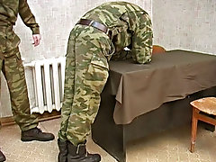 He spanks a soldier in OTK position, then releases a guy and orders him to jack off male twins spanking