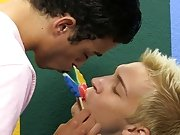 The two boys tongue the lollipop between them before tonguing each other as they trade blowjobs first time gay sex stories